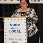 woman speaking ot podium